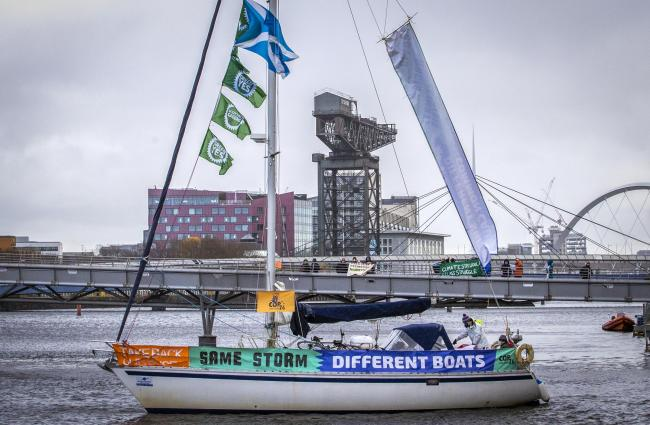 The Global Gathering began with a protest on the River Clyde