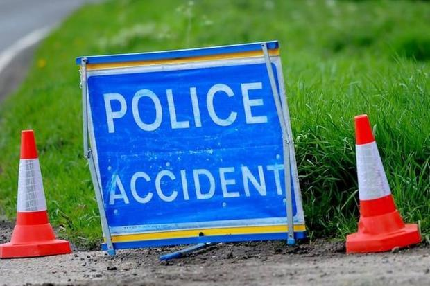 B9157: Emergency services dealing with crash as car overturned