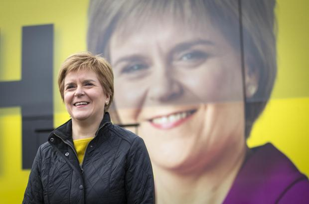 The National: Nicola Sturgeon in front of battlebus